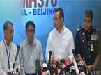 马来西亚政府举行新闻发布会 公布失联航班乘员最新调查情况